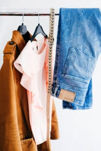 T-shirts and Jeans hung up on a clothing rail