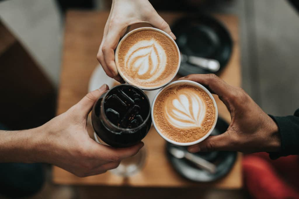 Three coffee cups together to show supporting local businesses