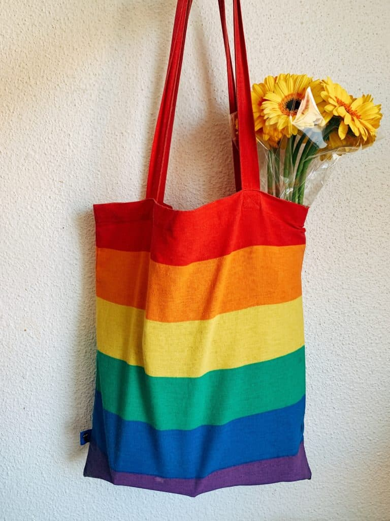 red blue and yellow striped tote bag