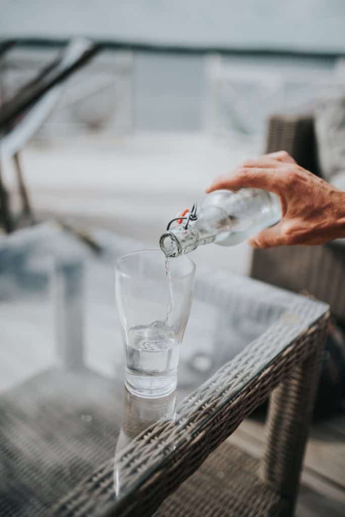 person pouring beverage